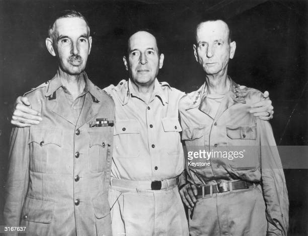 General and presidential candidate Douglas MacArthur at his headquarters in Yokohama Japan with US Lieutenant General Jonathan Wainwright and British...