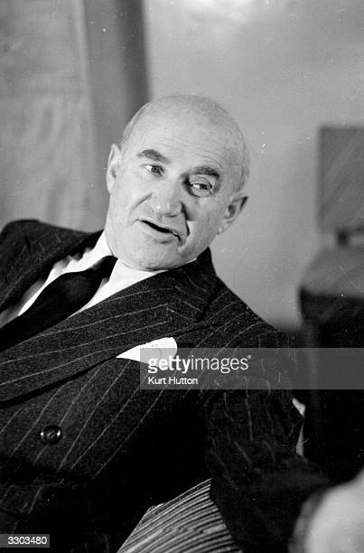 Polish born American film producer Samuel Goldwyn answering questions during a visit to London on behalf of the US government to discuss aspects of...