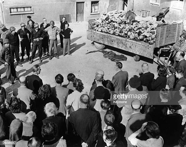 Weimar citizens under military police escort are forced to see for themselves the atrocities inside the concentration camp at Buchenwald