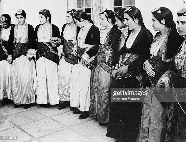 A group of Greek girls in national costume wait to take part in a ceremony commemorating the 1821 uprising or Greek War of Independence