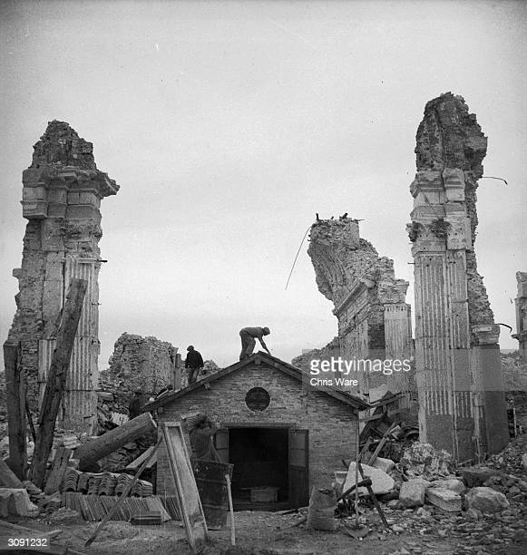 A small makeshift church rises amongst the ruins of the Abbey of Monte Cassino near Naples a Benedictine monastery dating back to 529 AD The building...