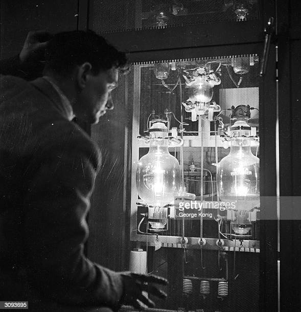 A technician at the BBC television station at Alexandra Palace London keeps an eye on one unit of the vision modulator in the vision transmitter room