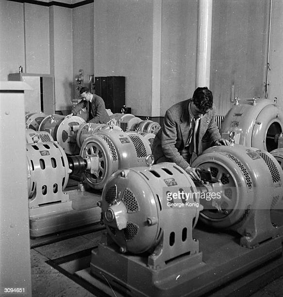 A technician checks the generator section of the vision transmitter room in the BBC television station at Alexandra Palace London The station is...