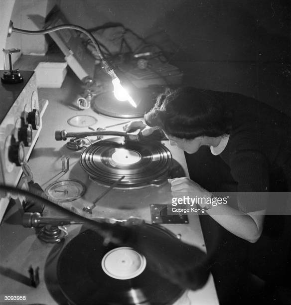 The control room of the BBC television station at Alexandra Palace London in which sound effects recorded scenes and a music soundtrack are added to...