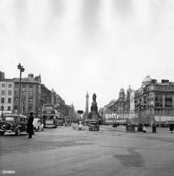 O'Connell Bridge and O'Connell Street Dublin with the O'Connell Monument and Nelson Pillar in the centre