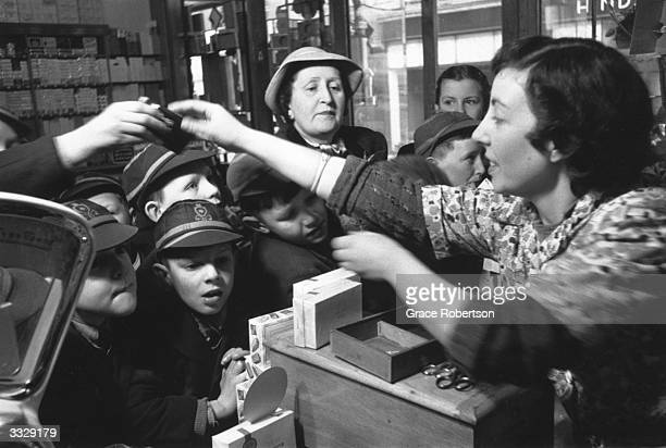 Customers including some eager schoolboys buying sweets in a sweet shop now that they are no longer rationed Original Publication Picture Post 6456...