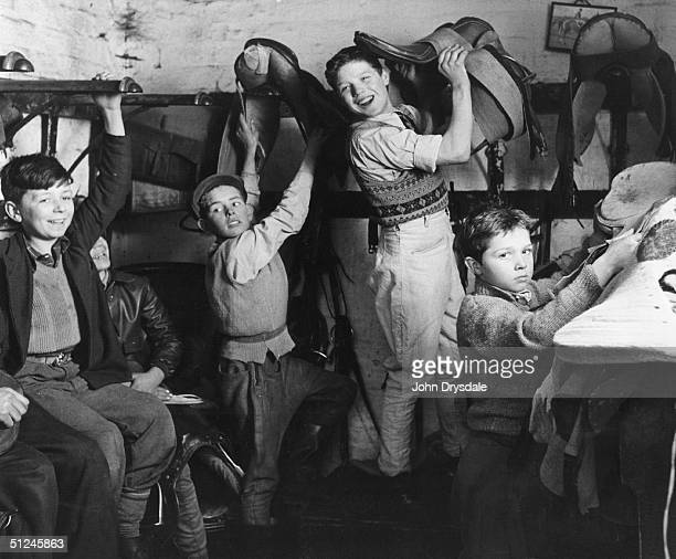 April 1956 14 year old Steve Donoghue apprentice jockey with his fellow stable lads preparing for work at the Ernest Magner stables in Doncaster