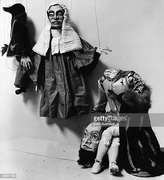 Puppets made by patients at a mental hospital, a judge, a duck and a headless figure. Original Publication: Illustrated - pub. 1956