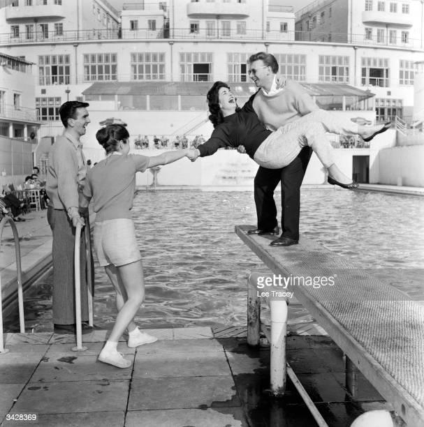 Honeymooning couples by the pool at Billy Butlin's Ocean Hotel in Saltdean near Brighton in Sussex