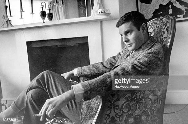 Louis Jourdan French film actor relaxing in the house he has rented in London that belongs to Tyrone Power Original Publication Picture Post 8885...
