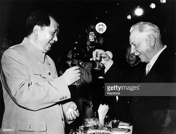 President of the USSR Klimenti Voroshilov on the right and Chairman Mao Zedong give a toast to SovietChinese friendship during the former's visit to...