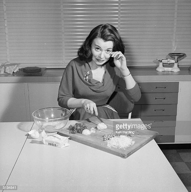 British film actress Anne Heywood chops the ingredients for a low calorie vegetarian hamburger which she has invented.