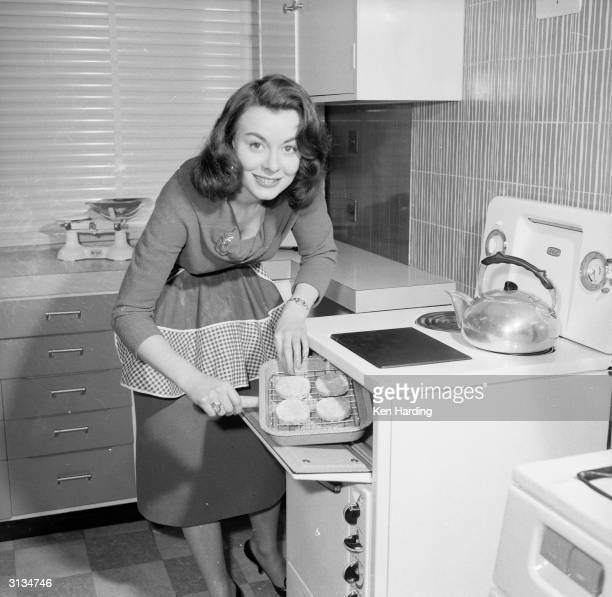 British film actress Anne Heywood grills a low calorie vegetarian hamburger which she has invented.