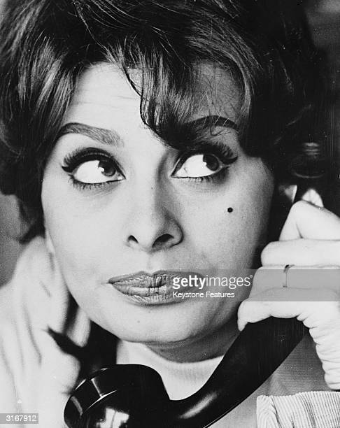 Italian film star Sophia Loren on the telephone to her mother At the time Loren was living in Switzerland with husband filmproducer Carlo Ponti The...