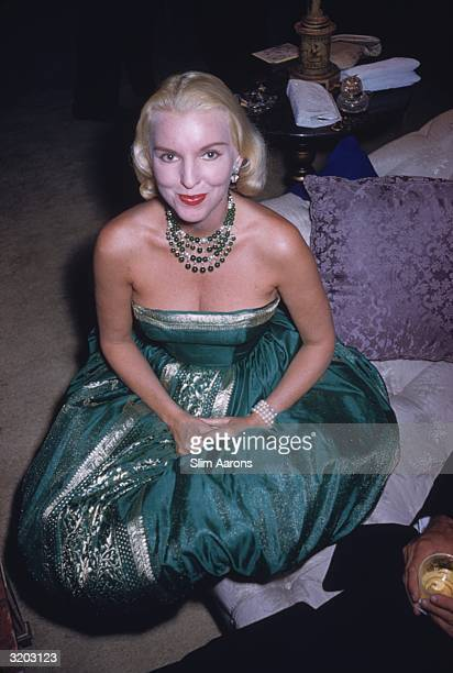 Socialite Brownie McLean wearing an emerald green ball gown at a party in Palm Beach Florida