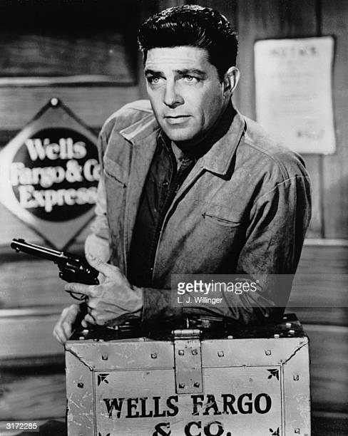 American actor Dale Robertson who starred in the popular TV western 'Tales of Wells Fargo' which ran from 1957 until 1962