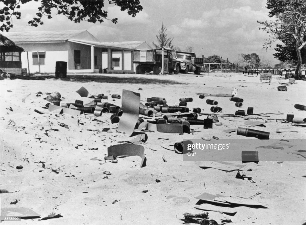 Artillery shells scattered on the beach at the holiday resort of Playa de Giron, Cuba, after the ill-fated 'Bay of Pigs' invasion.