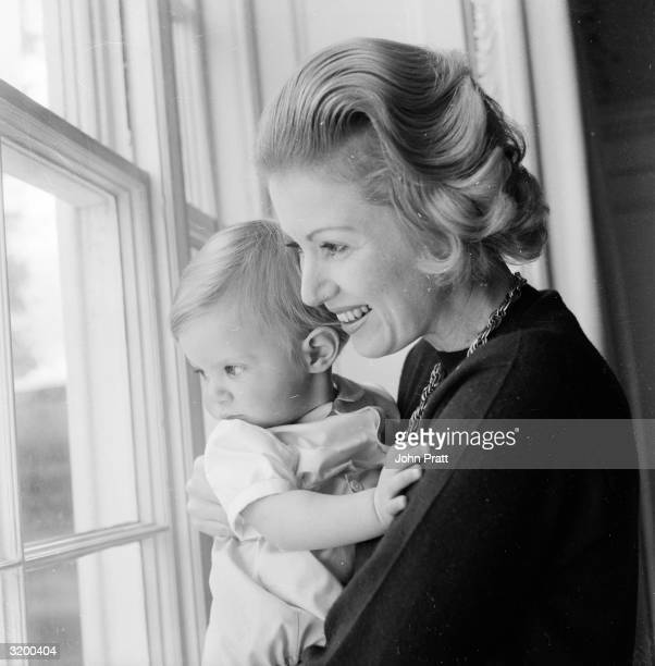 Lady Bathurst holding her one year old son the Lord Apsley at their family seat Cirencester Park in Gloucester