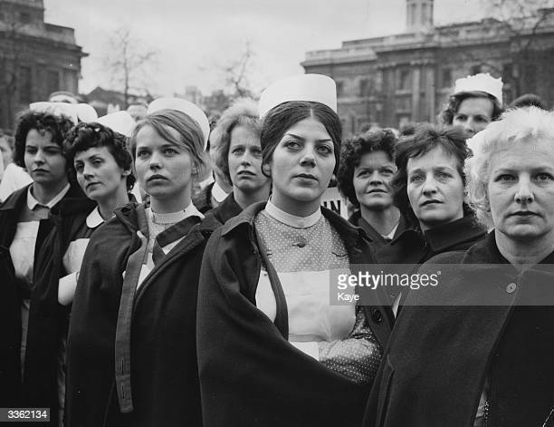 Some of the 8000 nurses attending a protest meeting at Trafalgar Square London in support of their pay claim