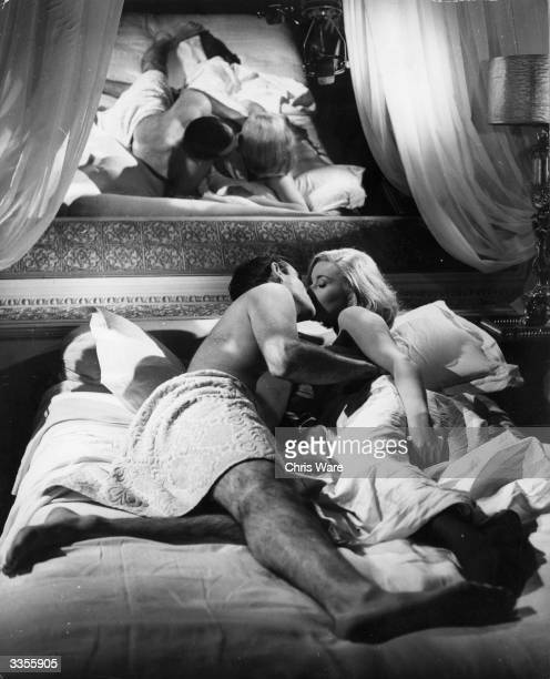 Scottish actor Sean Connery rehearses a bedroom scene with actress Daniela Bianchi, for the James Bond film 'From Russia With Love', directed by...
