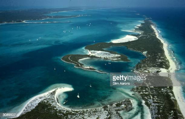 Stocking Island in the Bahamas Three miles long its many bays form safe anchorages called 'hurricane holes' A Wonderful Time Slim Aarons