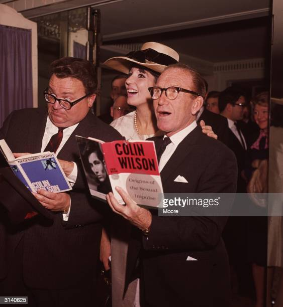 Welsh comedian writer and singer Harry Secombe with English singer Alma Cogan and comedian Arthur Askey at a Foyle's literary lunch