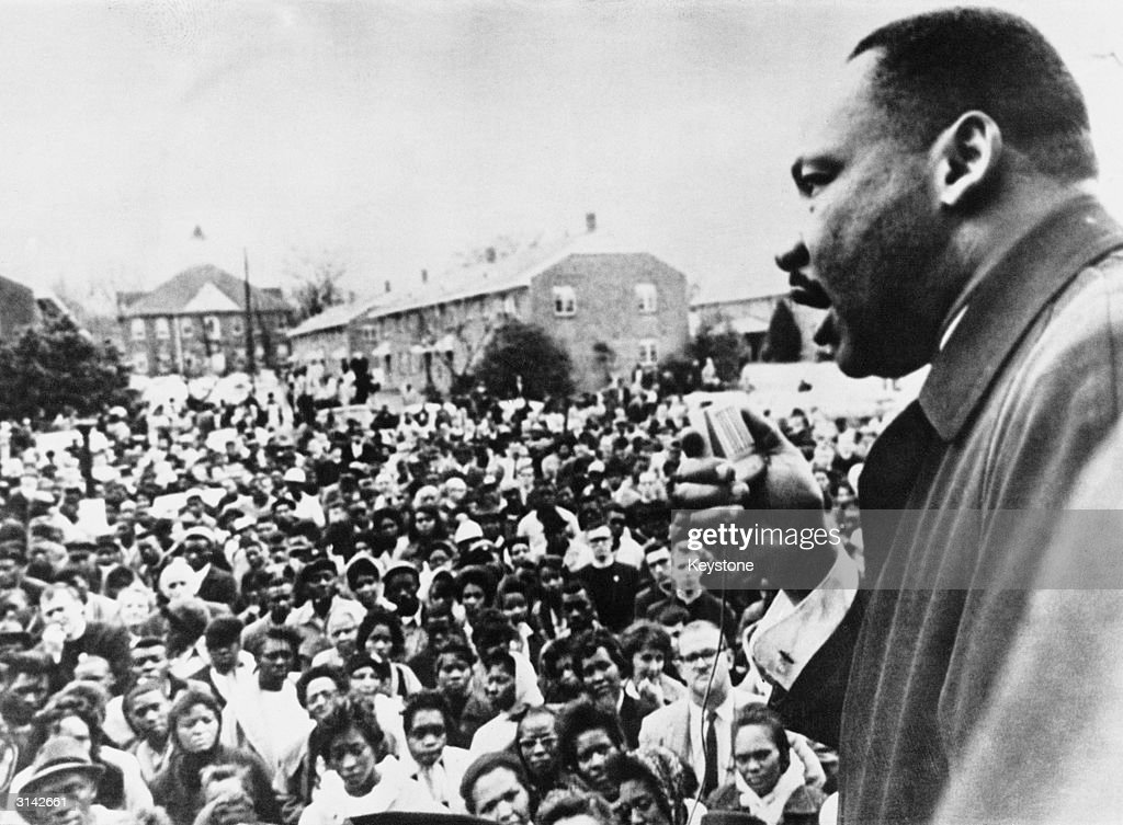 Dr Martin Luther King (1929 - 1968) addresses civil rights marchers in Selma, Alabama.