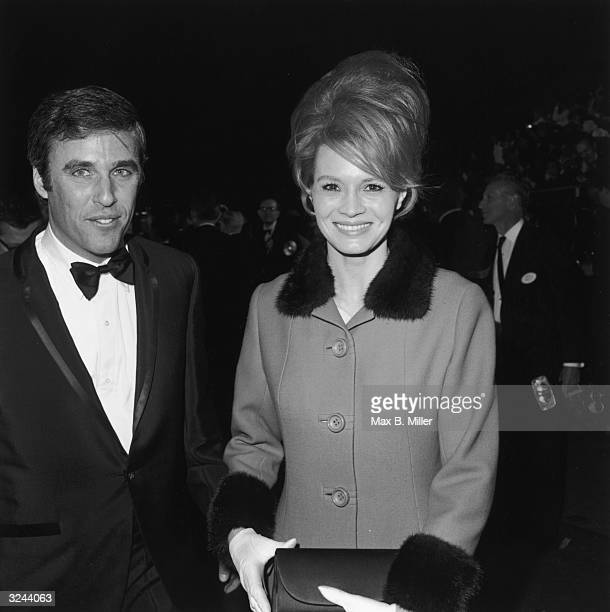 American actor Angie Dickinson with her husband American composer Burt Bacharach wearing a tuxedo at the Academy Awards Los Angeles California