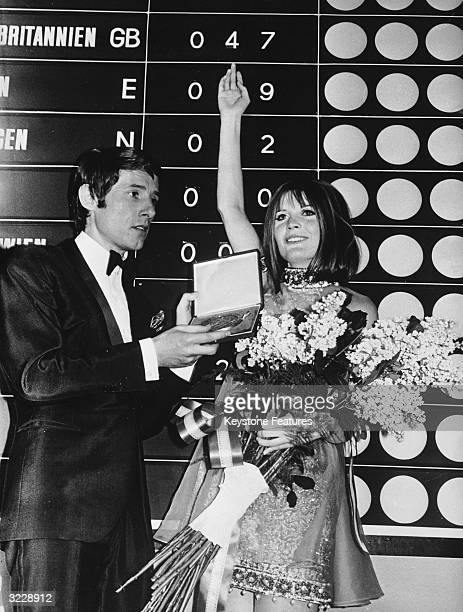 British singer Sandie Shaw receiving the winning trophy for the Eurovision Song Contest from last year's winner Udo Juergens Her winning song was...