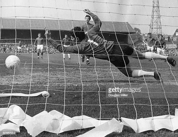 Ken Hancock the Ipswich Town goalkeeper fails to save Rodney Marsh's penalty in a match against Queen's Park Rangers FC