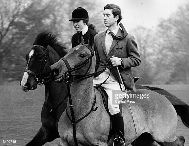 Charles, Prince of Wales and Princess Anne riding in the grounds of Windsor Castle, Berkshire.
