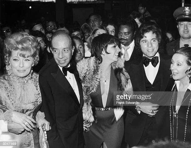 American actor Lucille Ball , director Vincente Minnelli , his daughter, actor and singer Liza Minnelli, actor Desi Arnaz Jr., and Minnelli's fiancee...