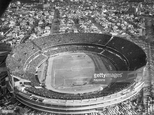 Crowd of approximately 80,000 watching a game at the River Plate football stadium in Buenos Aires.