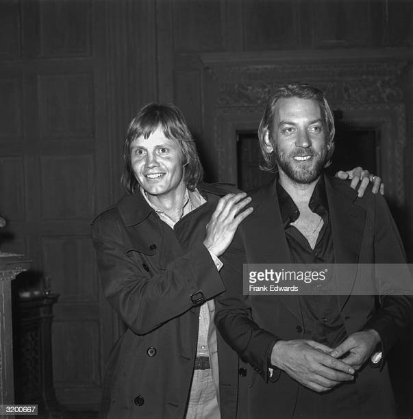 American actor Jon Voight places his hands on the shoulders of Canadian actor Donald Sutherland at the American Film Institute reception for Italian...