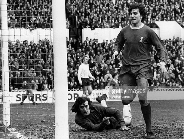 Liverpool's Peter Cormack puts one in the net for Liverpool as Tottenham Hotspur's gaoalkeeper can only lie on the ground and watch
