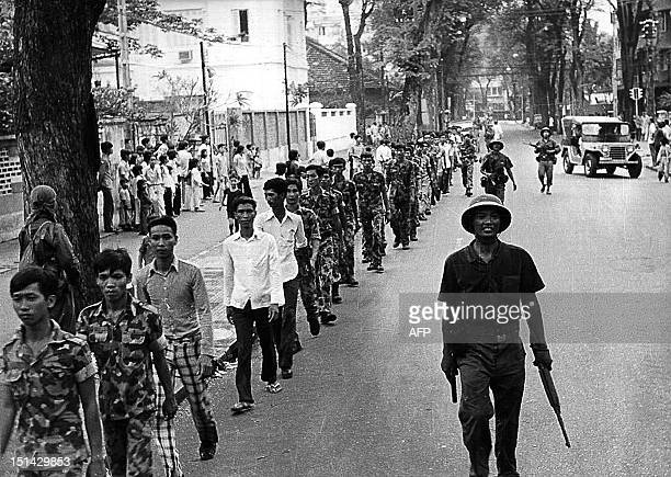 April 1975 photo shows a line of captured USbacked South Vietnamese Army soldiers escorted by Vietnamese communist soldiers as they walk on a Saigon...