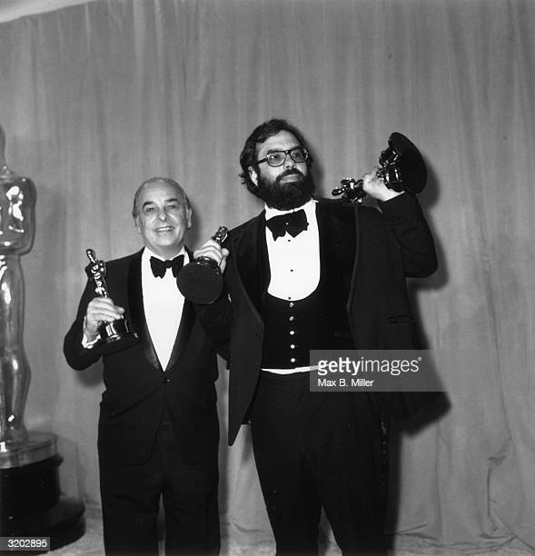 Portrait of American director Francis Ford Coppola with his father Carmine holding three of the six Academy Awards won by 'The Godfather Part II' Los...