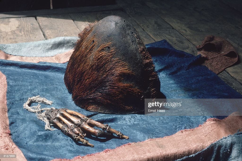 A preserved skull and hand said to be that of a yeti or abominable snowman on display at Pangboche monastery, near Mount Everest.
