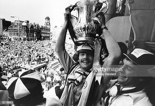 Alan Devonshire lifts the FA Cup over his head at a civic reception in West Ham to celebrate West Ham United's 10 victory over Arsenal in the FA Cup...
