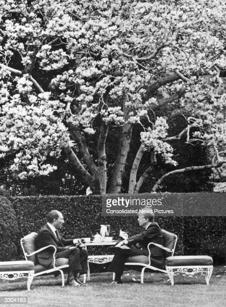 The army officer and Egyptian President Anwar Sadat left with Jimmy Carter 39th President of the United States of America on the south lawn at the...