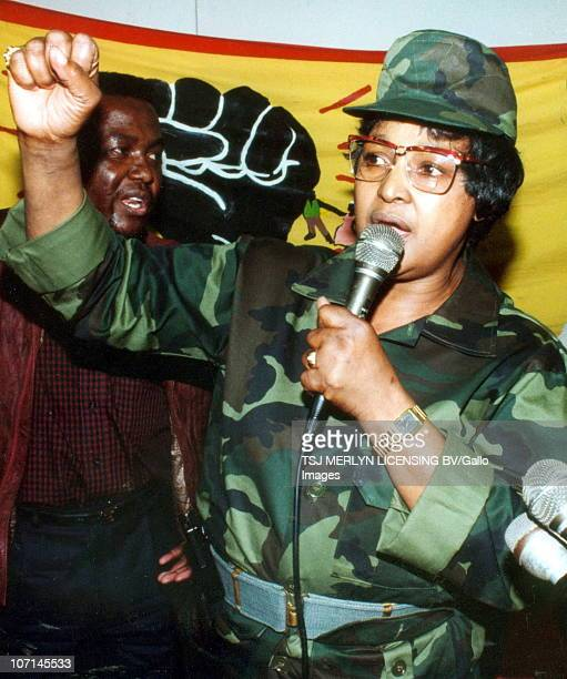 Winnie MadikizelaMandela in military attire speaks to supporters at the Umkhonto We Sizwe rally in Stellenbosch Behind her is Peter Mokaba