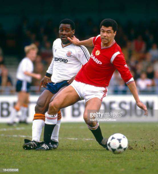 21 April 1985 Football League Division One Luton Town v Manchester United Paul McGrath wins the ball from Emeka Nwajiobi of Luton