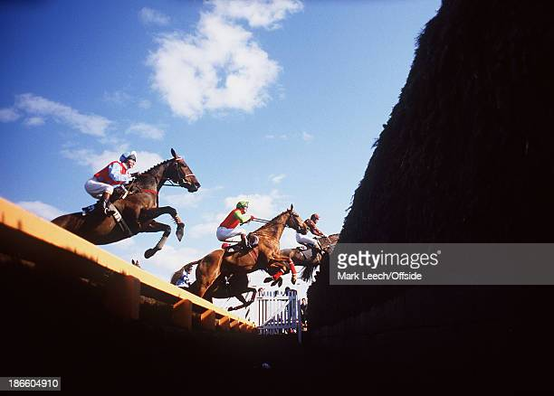 4 April 1986 Aintree Racecourse Horses jump the open ditch at The Chair fence