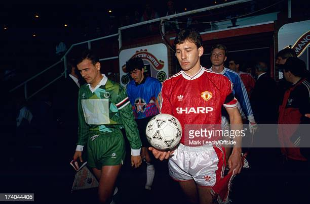 April 1991 European Cup Winners Cup - Manchester United v Legia Warsaw United captain Bryan Robson leads out his team.