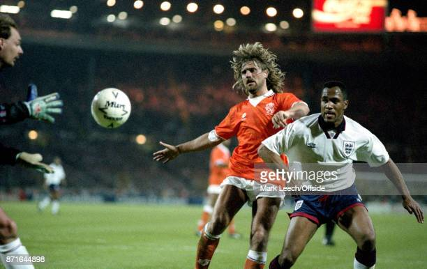 April 1993 Wembley : England v Netherlands :Dutch goalkeeper Ed de Goey comes out to gather the ball as Les Ferdinand of England is challenged by...