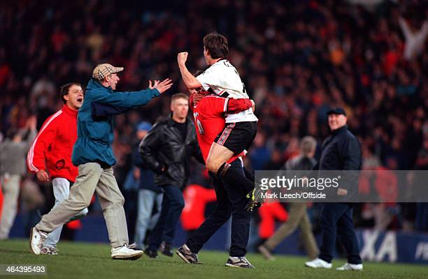 April 1999 - FA Cup Semi Final Replay - Manchester United v Arsenal FC - Gary Neville of Man United is picked up by a fan who has invaded the pitch...