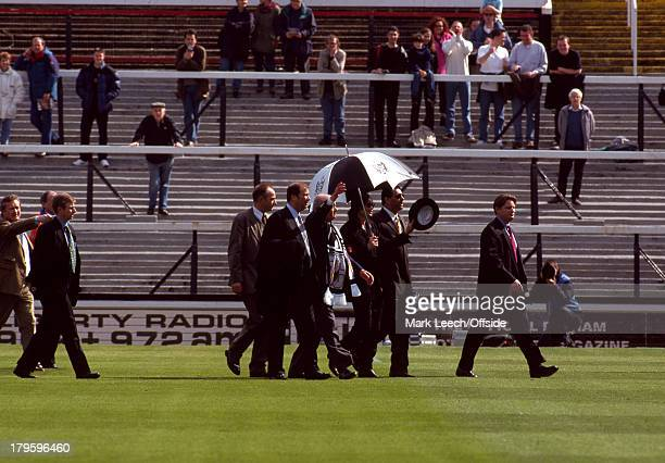 10 April 1999 Nationwide Football League Two Fulham v Wigan Athletic Fans stand on the terraces and watch as Michael Jackson visits Craven Cottage as...