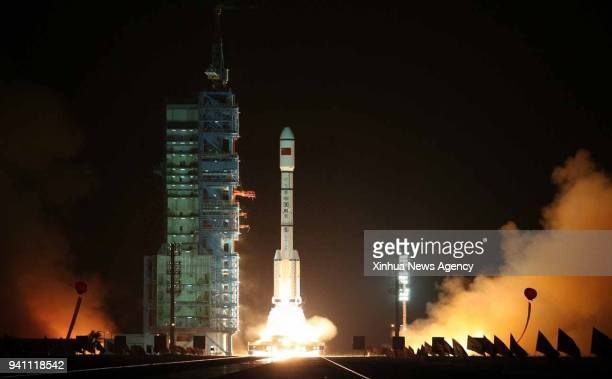 A Long March2FT1 carrier rocket loaded with Tiangong1 unmanned space lab module blasts off from the launch pad at the Jiuquan Satellite Launche...