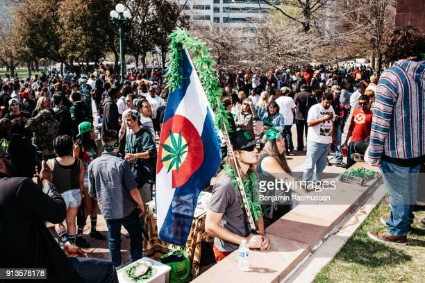 A large crowd of people exhale marijuana smoke at 420 PM on April 20 in celebration of 420 in Civic Center Park in Denver Colorado on April 20 2015...
