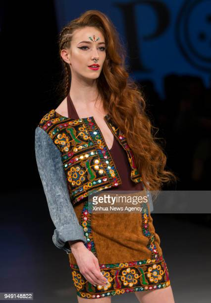 TORONTO April 20 2018 A model presents a creation by House of Poplyn during the 2018 Fashion Art Toronto event in Toronto Canada April 19 2018